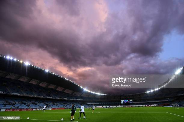 Real Madrid players warm up prior to the La Liga match between Real Sociedad and Real Madrid at Anoeta stadium on September 17, 2017 in San...