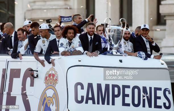 Real Madrid players with their trophy celebrating the team's win ontop of a bus on Plaza Cibeles in Madrid on June 4 2017 after the UEFA Champions...