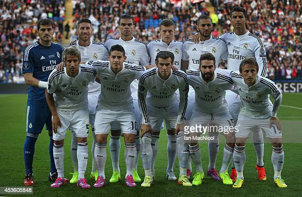 Real Madrid pose for a group photograph during the UEFA Super Cup match between Real Madrid and Sevilla at Cardiff City Stadium on August 12 2014...