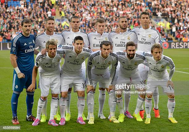 Real Madrid pose for a team group prior to the UEFA Super Cup match between Real Madrid and Sevilla FC at Cardiff City Stadium on August 12 2014 in...
