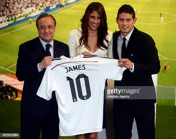 Real Madrid president Florentino Perez new transfer of Real Madrid James Rodriguez and his wife Daniela Ospina pose to media during the official...