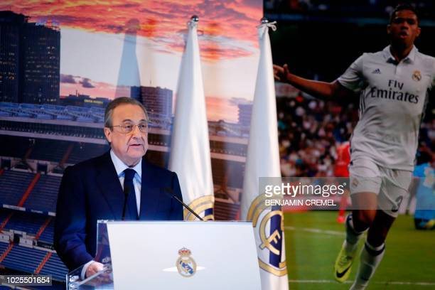 Real Madrid president Florentino Perez speaks to the press during the official presentation of Real Madrid's SpanishDominican forward Mariano at the...