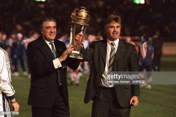 Real Madrid President Lorenzo Sanz and manager Guus Hiddink parade the World club championship trophy to the fans after Real's victory in Japan