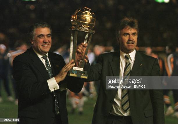 Real Madrid president Lorenzo Sanz and manager Guus Hiddink with the Toyota Cup trophy after Madrid beat Vasco 21 in Japan