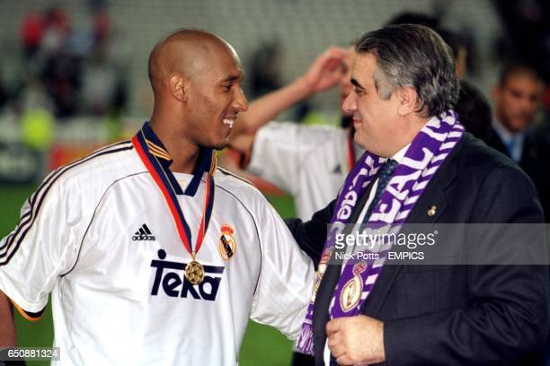 Real Madrid president Lorenzo Sanz talks to Nicolas Anelka after the match