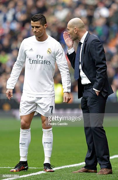 Real Madrid 's coach Zinedine Zidane gives instructions to his player Cristiano Ronaldo during the La Liga match between Real Madrid CF and Athletic...