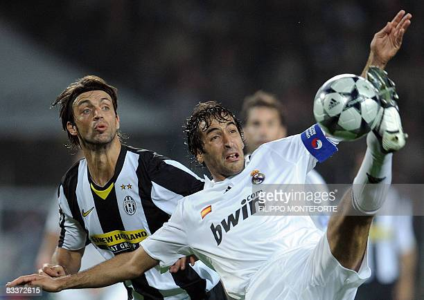 Real Madrid 's forward Raul fights for the ball with Juventus defender Nicola Legrottaglie during their Group H Champion's League football match on...