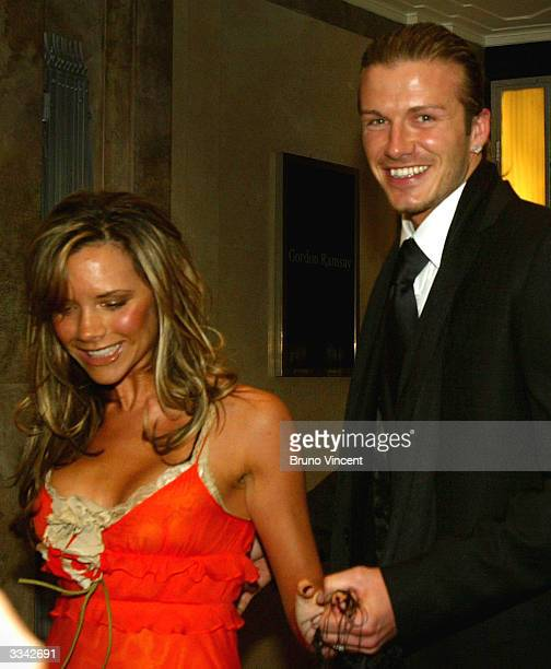 Real Madrid soccer player David Beckham and his wife, Victoria Beckham, leave Claridges Hotel April 12, 2004 in London, England.