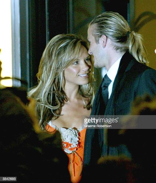 Real Madrid soccer player David Beckham and his wife Victoria Beckham meet the media as they leave Claridges Hotel April 12 2004 in London England