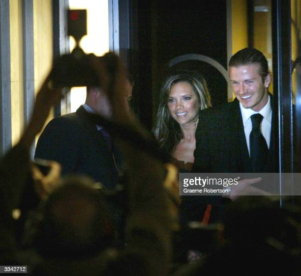 Real Madrid soccer player David Beckham and his wife, Victoria Beckham, meet the media as they leave Claridges Hotel April 12, 2004 in London,...