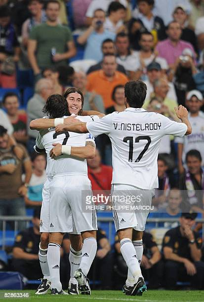 Real Madrid' Spanish defender Sergio Ramos celebrates his goal against Bate Borisov with teammates Raul and Ruud Van Nistelrooy during their...