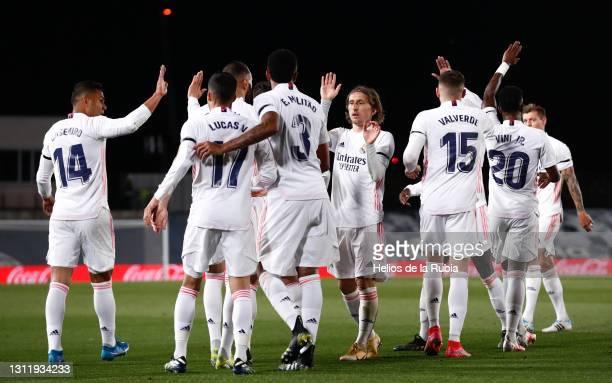 Real Madrid squad celebrates during the La Liga Santander match between Real Madrid and FC Barcelona at Estadio Alfredo Di Stefano on April 10, 2021...