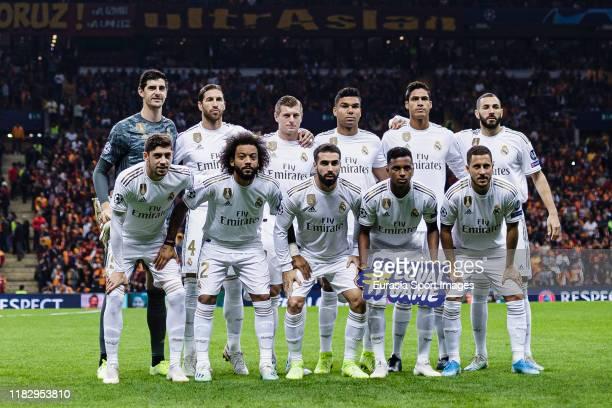 Real Madrid squad pose for team photo with Goalkeeper Thibaut Courtois Sergio Ramos Toni Kroos Carlos Casemiro Raphael Varane Karim Benzema Federico...