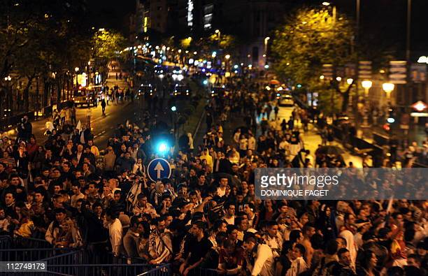 Real Madrid supporters celebrate at Cibeles fountain in Madrid on April 20 after Real Madrid won the Spanish Cup final match Real Madrid against...