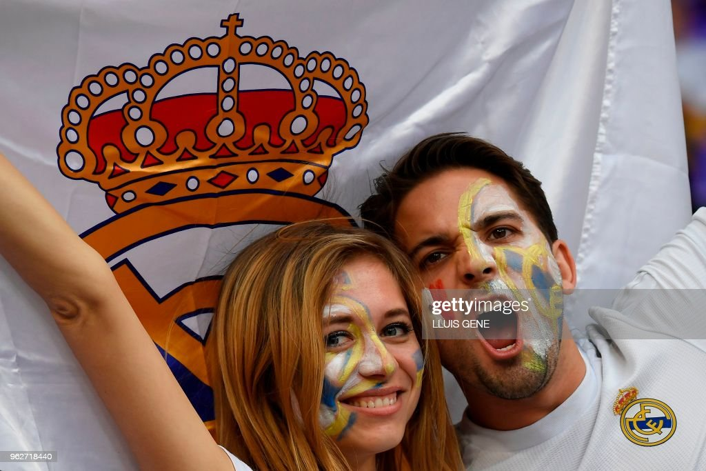 TOPSHOT - Real Madrid supporters cheer their team before the UEFA Champions League final football match between Liverpool and Real Madrid at the Olympic Stadium in Kiev, Ukraine on May 26, 2018.