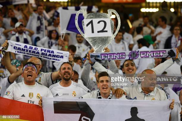 Real Madrid supporters hold up a tin foil trophy in the crowd as the atmosphere builds inside the stadium ahead of the UEFA Champions League final...