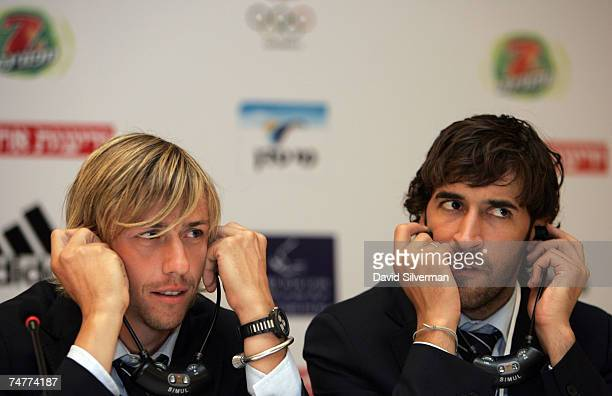 Real Madrid team captain Raul Gonzalez and player Guti use simultaneous translation headphones during a press conference ahead of tonight's Peace...