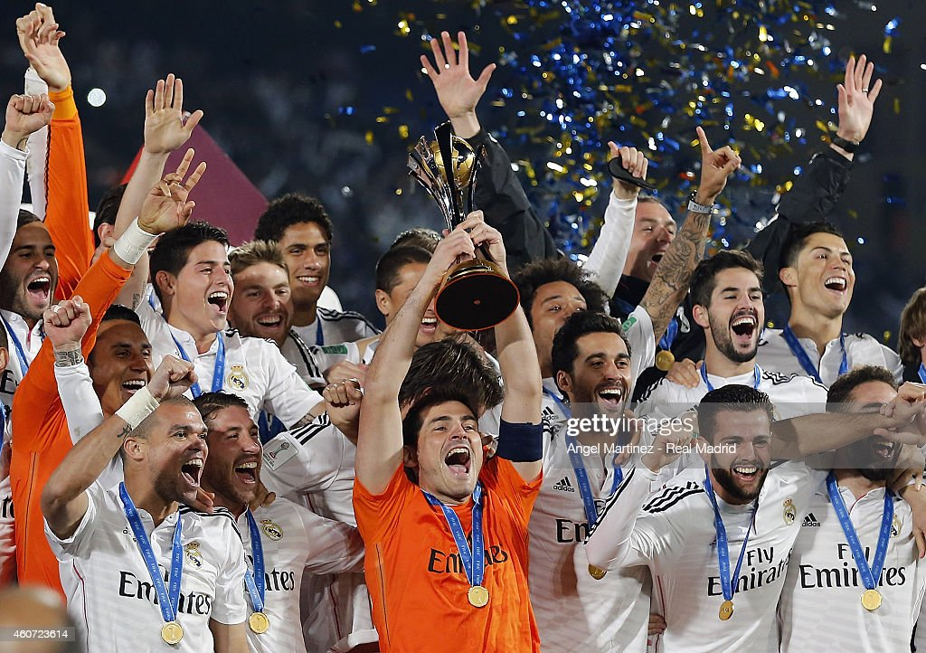 Real Madrid team celebrate with the trophy after the FIFA Club World Cup Final match between Real Madrid CF and CA San Lorenzo at Le Grand Stade de Marrakech on December 20, 2014 in Marrakech, Morocco.