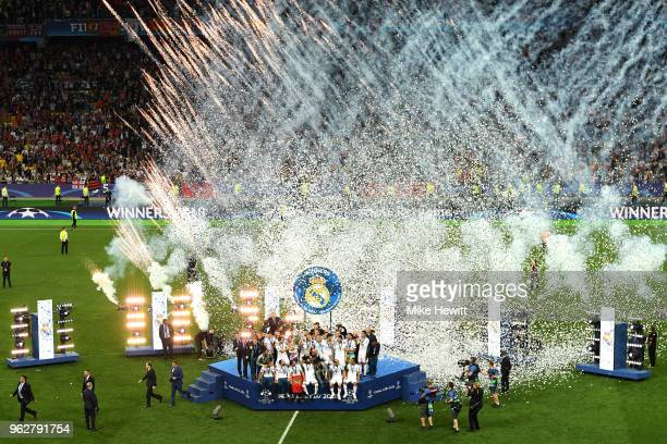 Real Madrid team celebrate with the UEFA Champions League trophy following their victory in the UEFA Champions League Final between Real Madrid and...