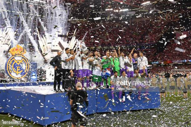 Real Madrid team celebrates with The Champions League trophy after the UEFA Champions League Final between Juventus and Real Madrid at National...