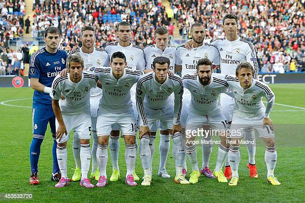 Real Madrid team line up before the UEFA Super Cup match between Real Madrid and Sevilla at Cardiff City Stadium on August 12 2014 in Cardiff United...