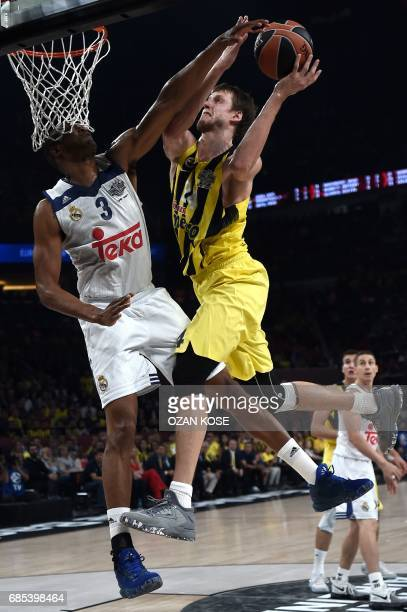 Real Madrid Trey Thompkins vies with Fenerbahce Jan Vesely during the semifinal basketball match between Fenerbahce Ulker vs Real Madrid at the...