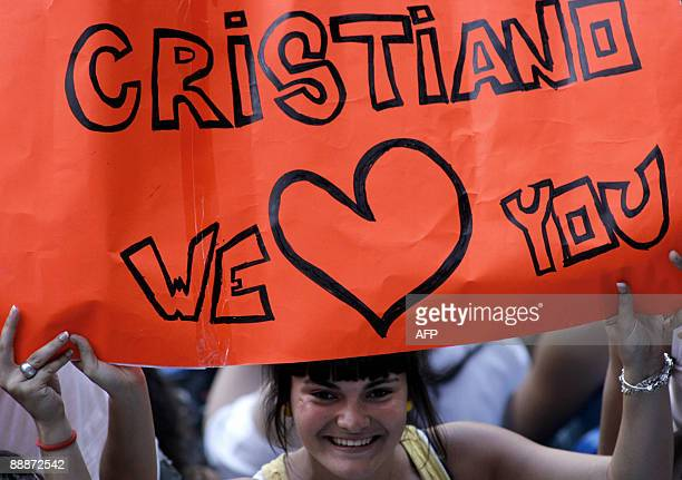 A Real Madrid young supporter waits for the official presentation of Real Madrid's new player Portuguese Cristiano Ronaldo at the Santiago Bernabeu...