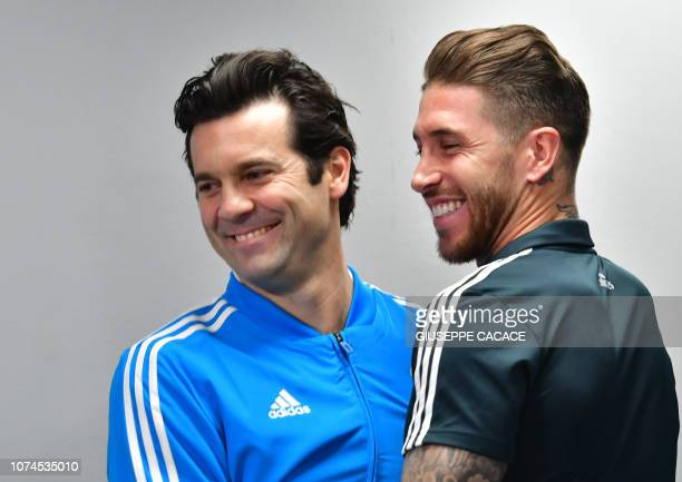 Real Madrid's Argentinian coach Santiago Solari embraces his Spanish defender and captain Segio Ramos as they attend a press conference on the eve of...