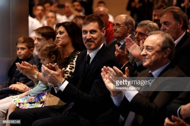 Real Madrid's Argentinian forward Andres Nocioni and Real Madrid's president Florentino Perez attend a press conference organised by the club after...