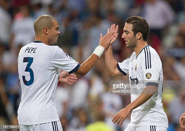 Real Madrid's Argentinian forward Gonzalo Higuain celebrates with teammate Real Madrid's Portuguese defender Pepe during the Spanish League football...