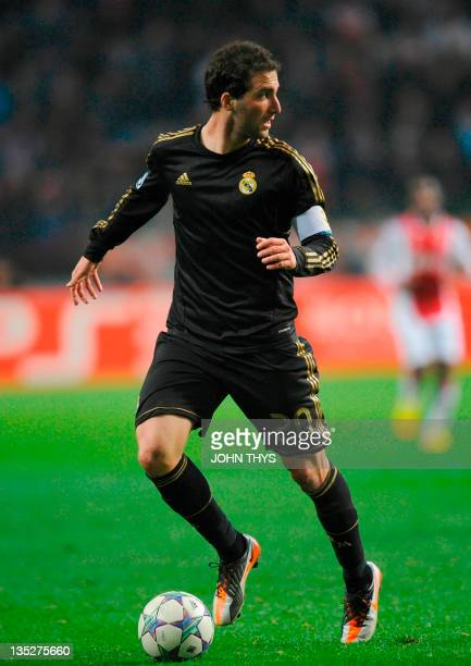 Real Madrid's Argentinian forward Gonzalo Higuain fights for the ball during the the UEFA Champions League Group E football match between Ajax and...