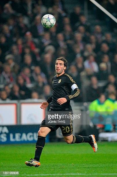 Real Madrid's Argentinian forward Gonzalo Higuain scores during the UEFA Champions League Group E football match between Ajax Amsterdam and Real...