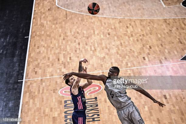 Real Madrid's Argentinian guard Nicolas Laprovittola challenges ASVEL's French centre Moustapha Fall during the Euroleague basketball match between...