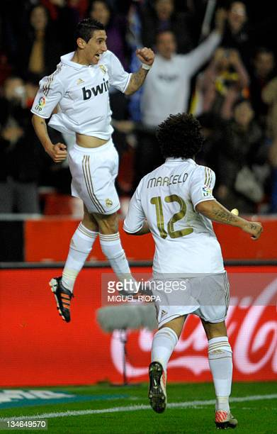 Real Madrid's Argentinian midfielder Angel di Maria celebrates after scoring a goal during the Spanish league football match Sporting Gijon vs Real...