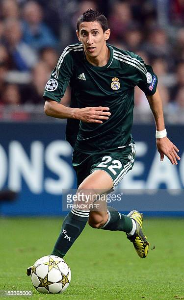 Real Madrid's Argentinian midfielder Angel di Maria controls the ball during the UEFA Champions League Group D football match Ajax Amsterdam vs Real...
