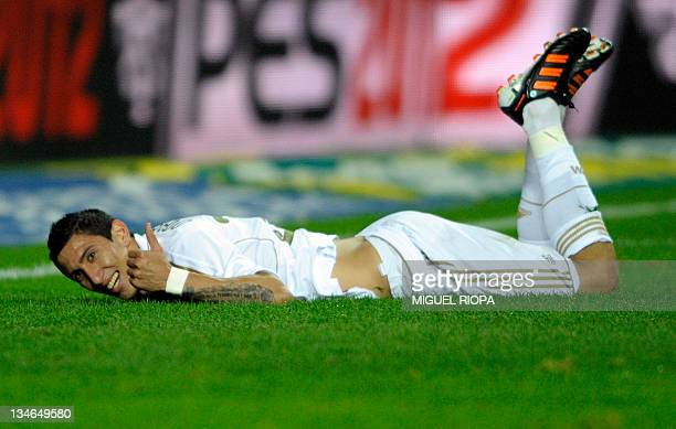 Real Madrid's Argentinian midfielder Angel di Maria reacts after missing a goal opportunity during the Spanish league football match Sporting Gijon...