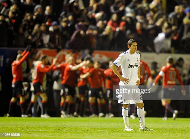 Real Madrid's Argentinian midfielder Angel di Maria reacts as CA Osasuna's football players celebrate scoring during the Spanish league football...