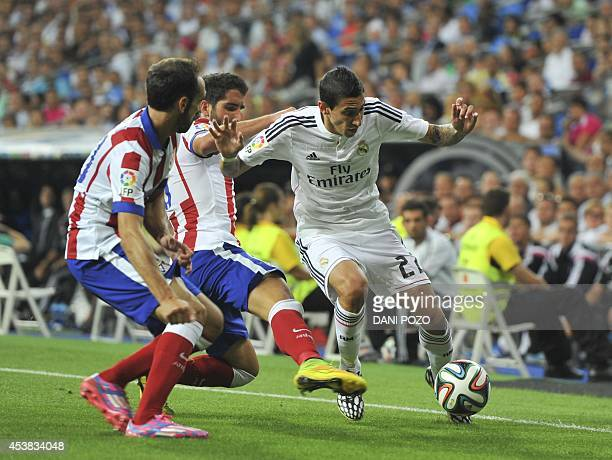 Real Madrid's Argentinian midfielder Angel di Maria vies with Atletico Madrid's midfielder Raul Garcia during the Spanish Supercup firstleg football...