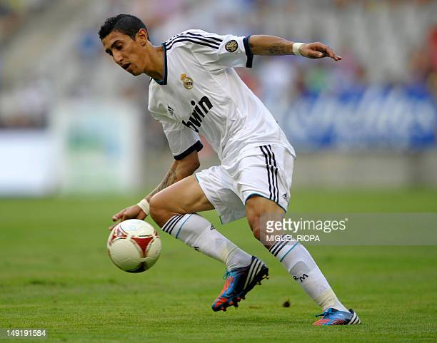 Real Madrid's Argentinian player Angel Di Maria dribbles during the friendly football match between Real Madrid and Real Oviedo at the Carlos...