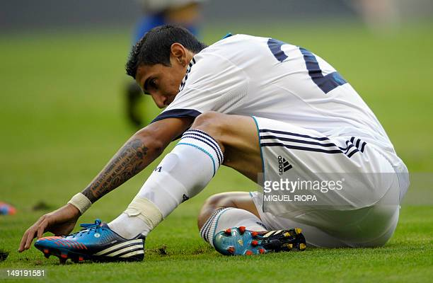 Real Madrid's Argentinian player Angel Di Maria reacts during the friendly football match between Real Madrid and Real Oviedo at the Carlos Tartiere...