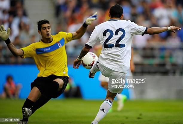 Real Madrid's Argentinian player Angel Di Maria scores past Real Oviedo's goalkeeper Dani Barrio during their friendly football match at the Carlos...