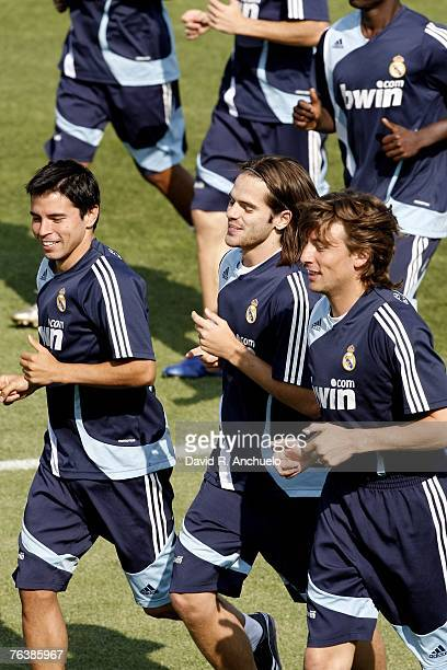 Real Madrid's Argentinian players Javier Saviola, Fernando Gago and Gabriel Heinze run during a training session at Real's Valdebebas sports facility...