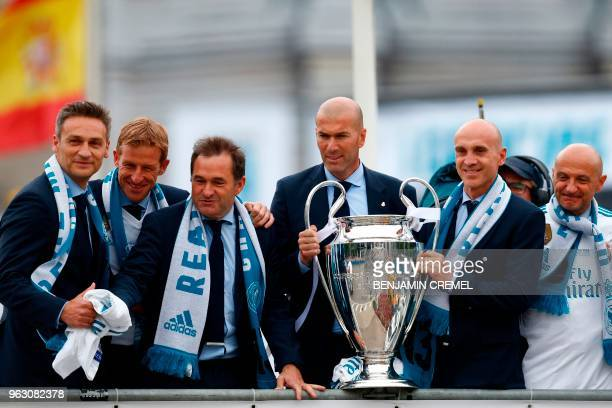 TOPSHOT Real Madrid's assistant coaches Jose Carlos Parrales Javir Mallo LLuis Lopies Real Madrid's French coach Zinedine Zidane assistant coach...