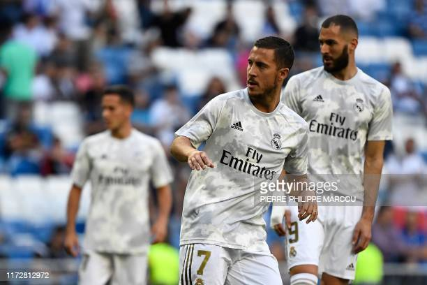 Real Madrid's Belgian forward Eden Hazard and Real Madrid's French forward Karim Benzema warm up prior to the UEFA Champions league Group A football...