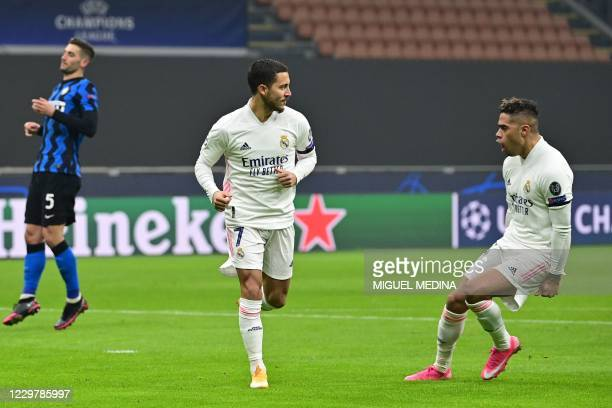 Real Madrid's Belgian forward Eden Hazard celebrates scoring a penalty with Real Madrid's Dominicans forward Mariano during the UEFA Champions League...
