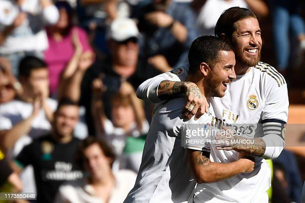 Real Madrid's Belgian forward Eden Hazard celebrates with ramos scoring his team's second goal during the Spanish league football match between Real...