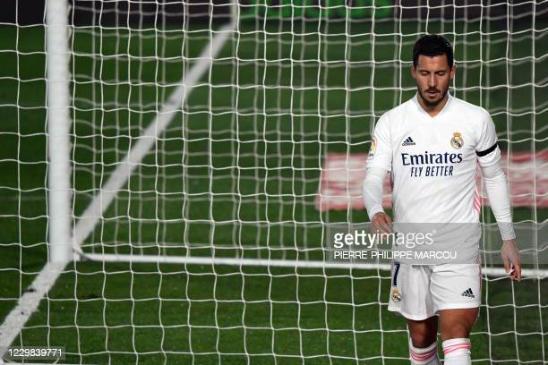 Real Madrid's Belgian forward Eden Hazard leaves the pitch during the Spanish League football match between Real Madrid and Deportivo Alaves at the...
