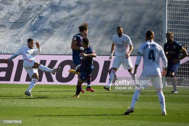 Real Madrid's Belgian forward Eden Hazard scores a goal during the Spanish League football match between Real Madrid and SD Huesca at the Alfredo Di...
