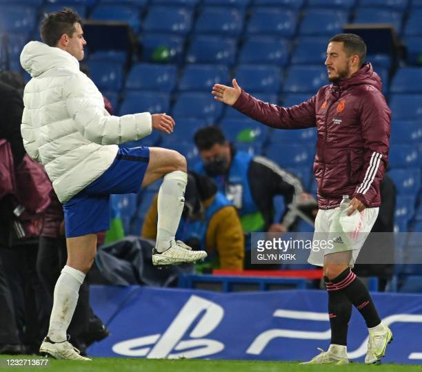 Real Madrid's Belgian forward Eden Hazard shakes hands with Chelsea's Spanish defender Cesar Azpilicueta after the UEFA Champions League second leg...
