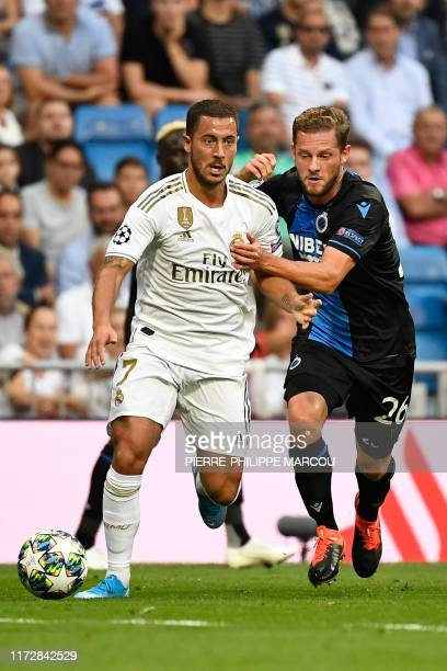 Real Madrid's Belgian forward Eden Hazard vies with Club Brugge's Belgian midfielder Mats Rits during the UEFA Champions league Group A football...